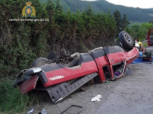 Two trapped people were extricated from this overturned pickup truck along Highway 6 near Lavington on Thursday evening.