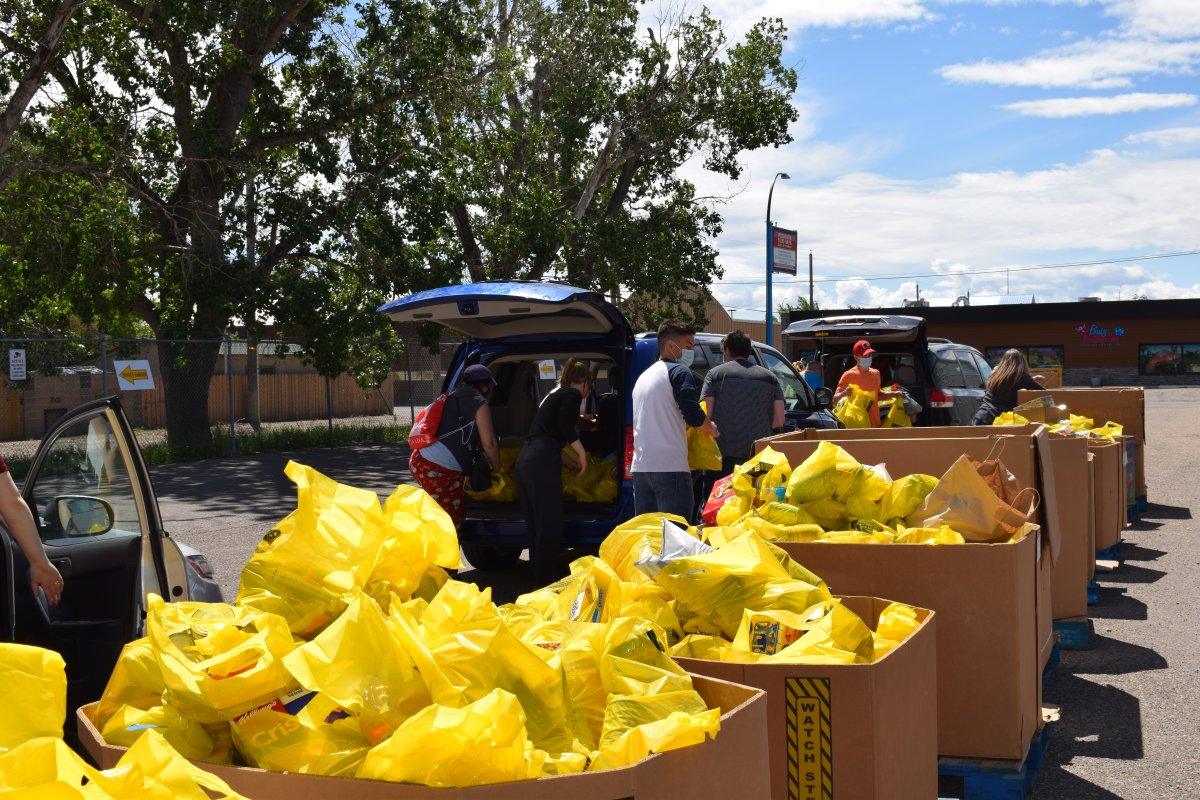 Volunteers collect food donations for the 2021 Target Hunger campaign in Lethbridge.