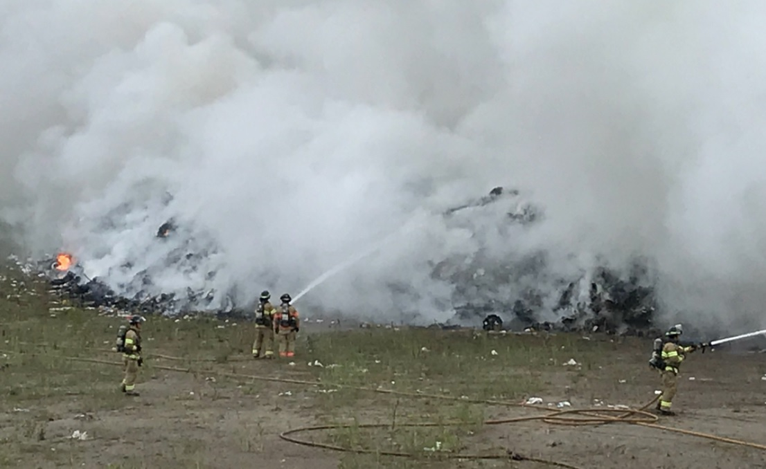 London fire crews battled a large and smoky fire at a landfill on Manning Drive.