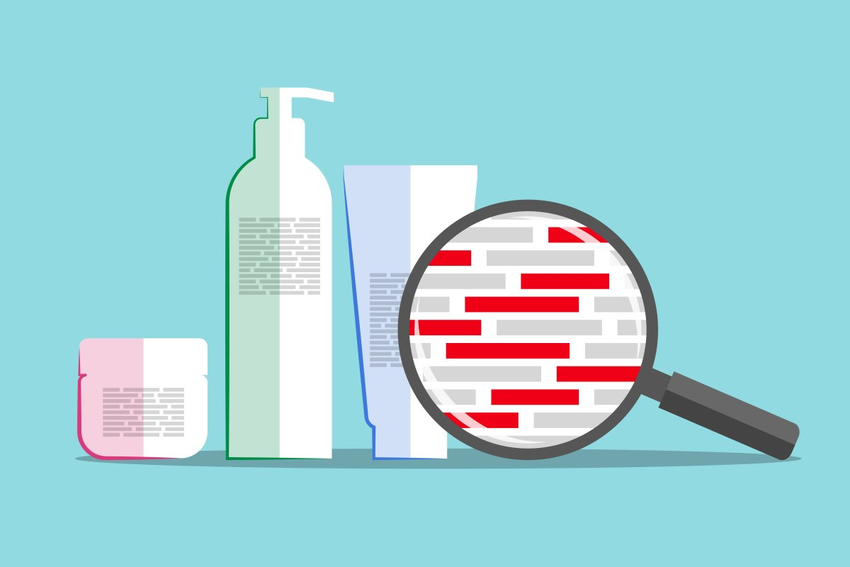 Different cosmetics and magnifier above info about chemical composition.