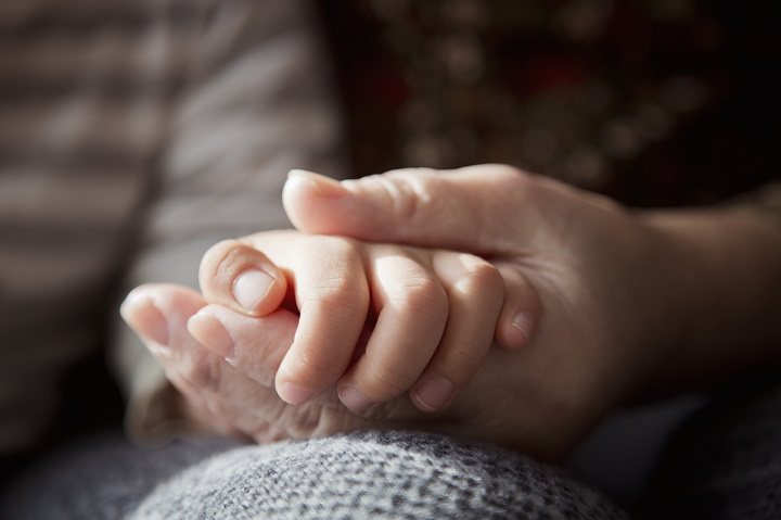 A hand of grand mother taking her grandson by the hand. The government has named Anna Panasuk as a liaison between the government and Indigenous families who request information about missing loved ones. Wednesday, June 9, 2021.