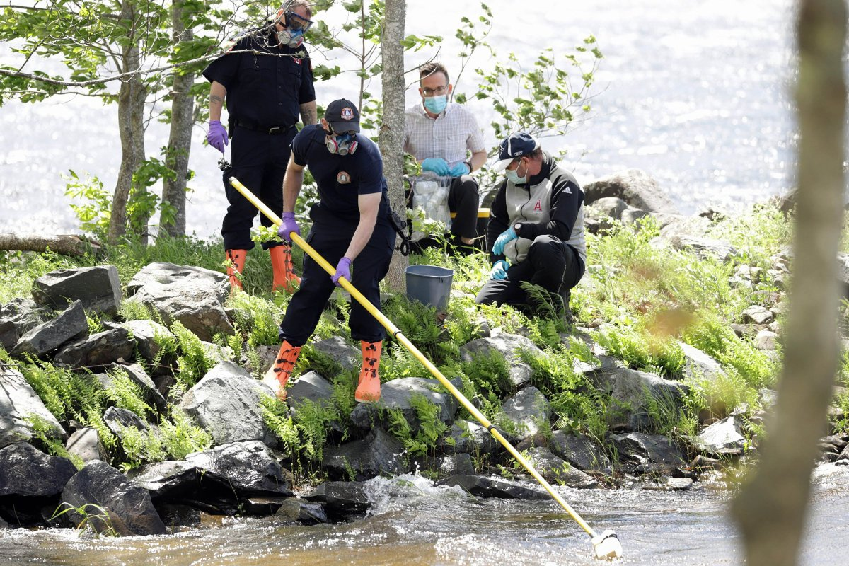 Staff from the Department of Environment and Climate Change, assisted by members of Halifax Regional Fire & Emergency, take water samples from Grand Lake Thursday, June 10, to test for toxins.