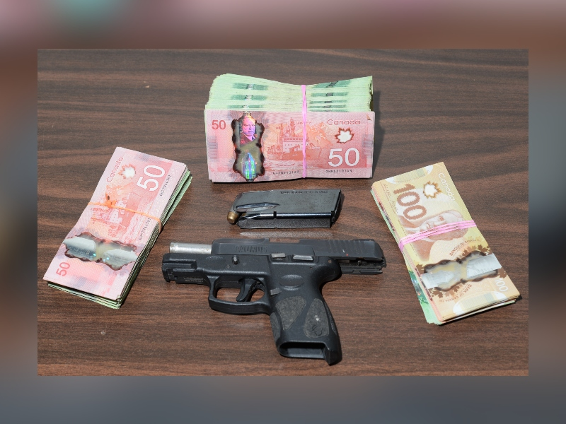 Guelph police seized a loaded handgun and $15,000 in cash on Saturday night.