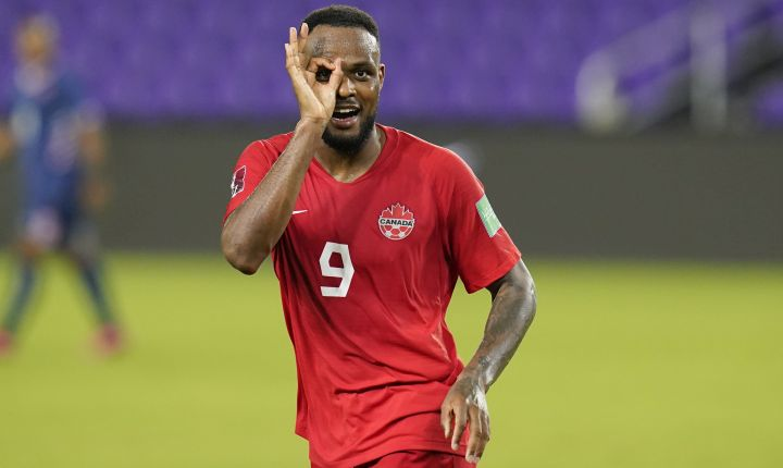 Canada forward Cyle Larin (9) gestures after scoring his third goal against Bermuda during the second half of a World Cup 2022 Group B qualifying soccer match, Thursday, March 25, 2021, in Orlando, Fla.