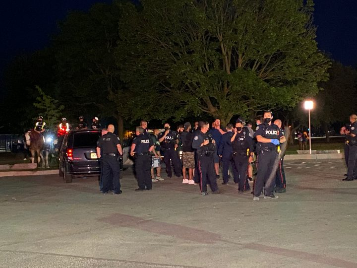 Officers are seen at Ashbridge's Bay Park on Saturday after a stabbing.