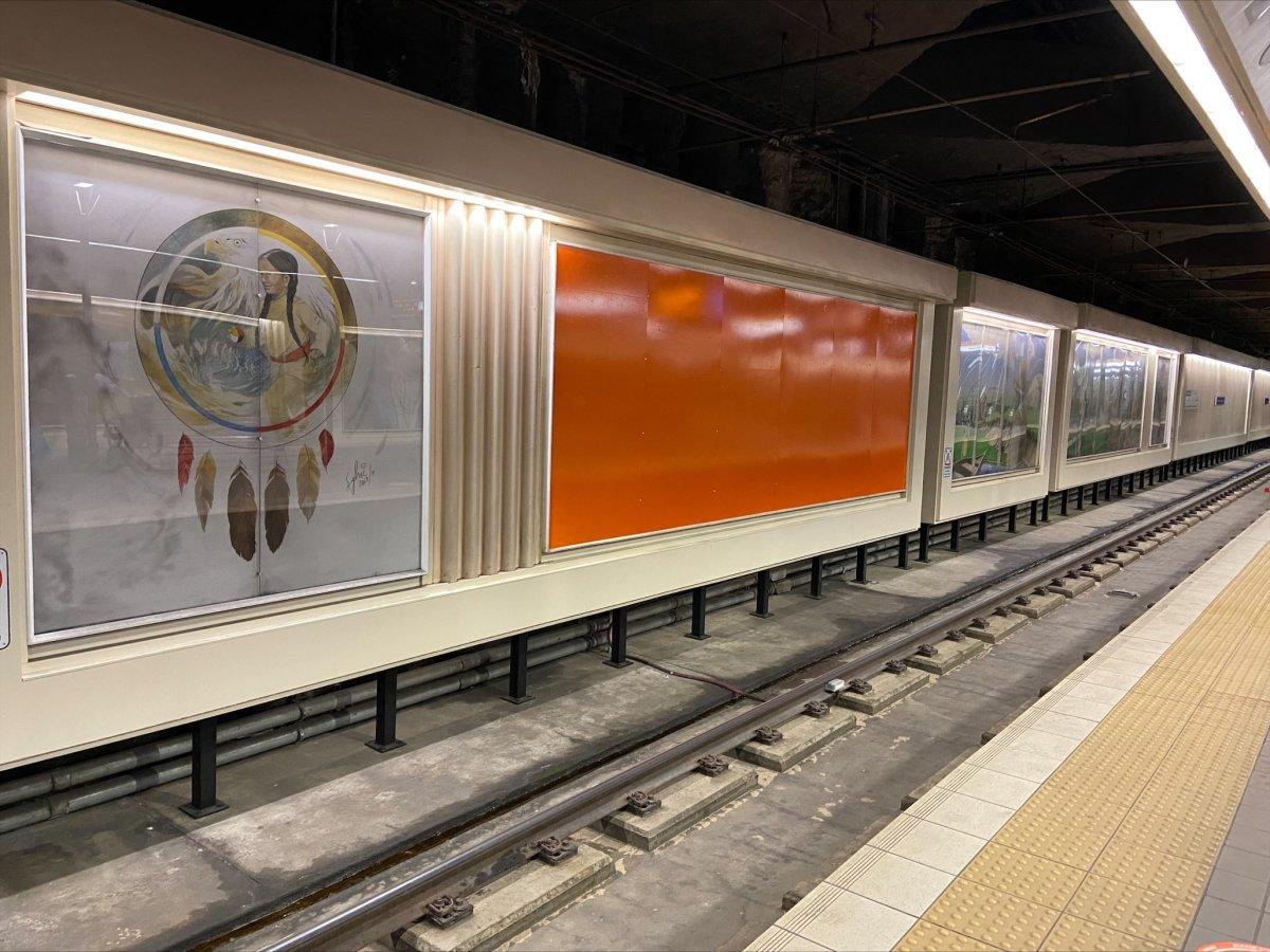 The mural depicting Bishop Vital-Justin Grandin at an Edmonton LRT Station was covered in orange Tuesday, June 8, 2021.