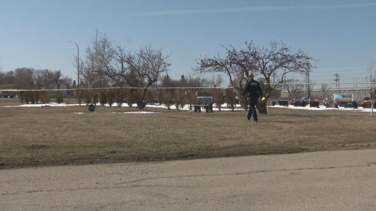 Police investigate a crime scene at Thompson in the Park Funeral Home and Cemetery.