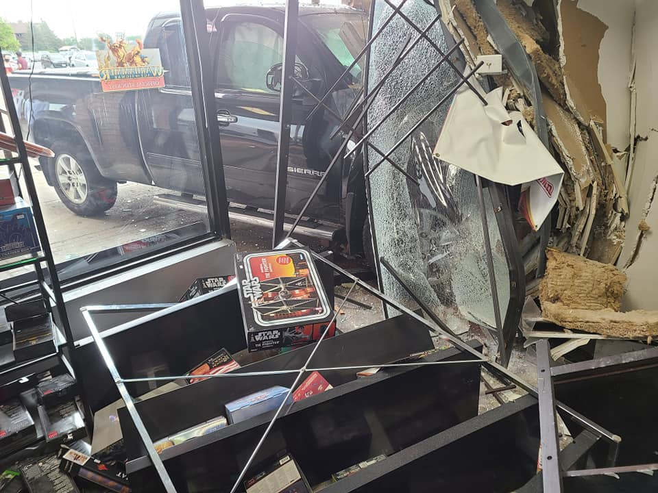 Kingston police say the driver of the vehicle lost control of the truck and crashed it into the front of SBT Comics and Games in the city's west end.
