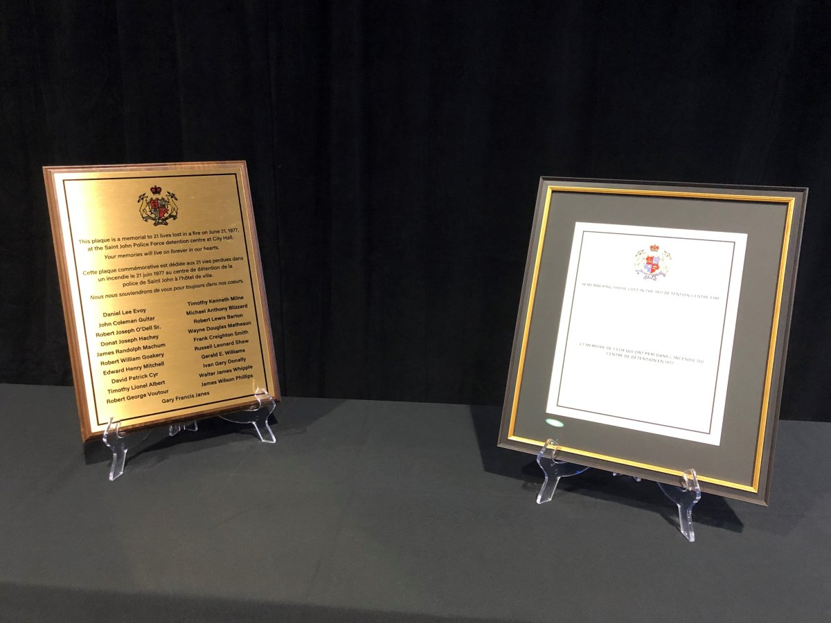 Officials in Saint John unveiled a memorial plaque to recognize 21 men killed in a fire at the former Saint John detention centre on June 21, 1977.