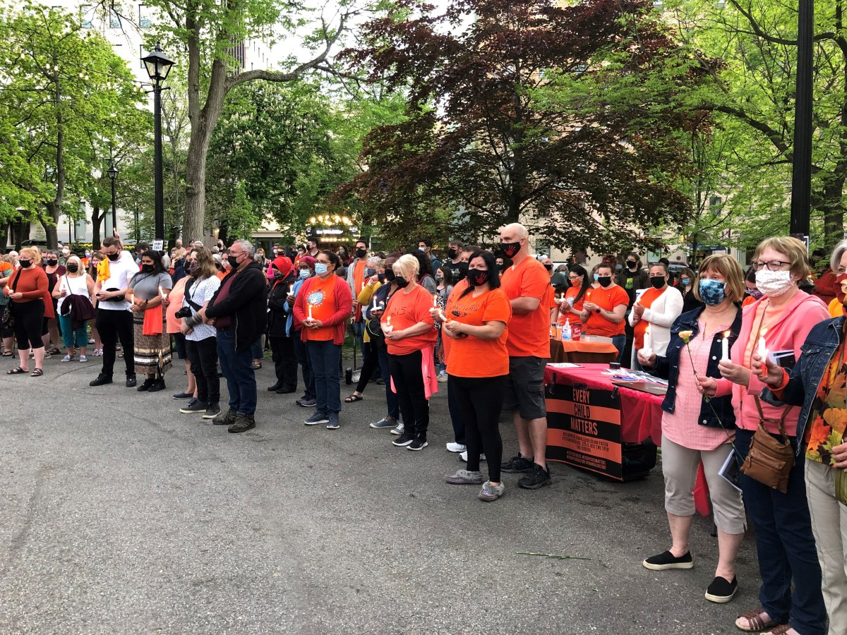 Hundreds gathered at Kings Square in Saint John for a candlelight vigil in recognition of the 215 children discovered buried near a former Indian residential school in British Columbia.