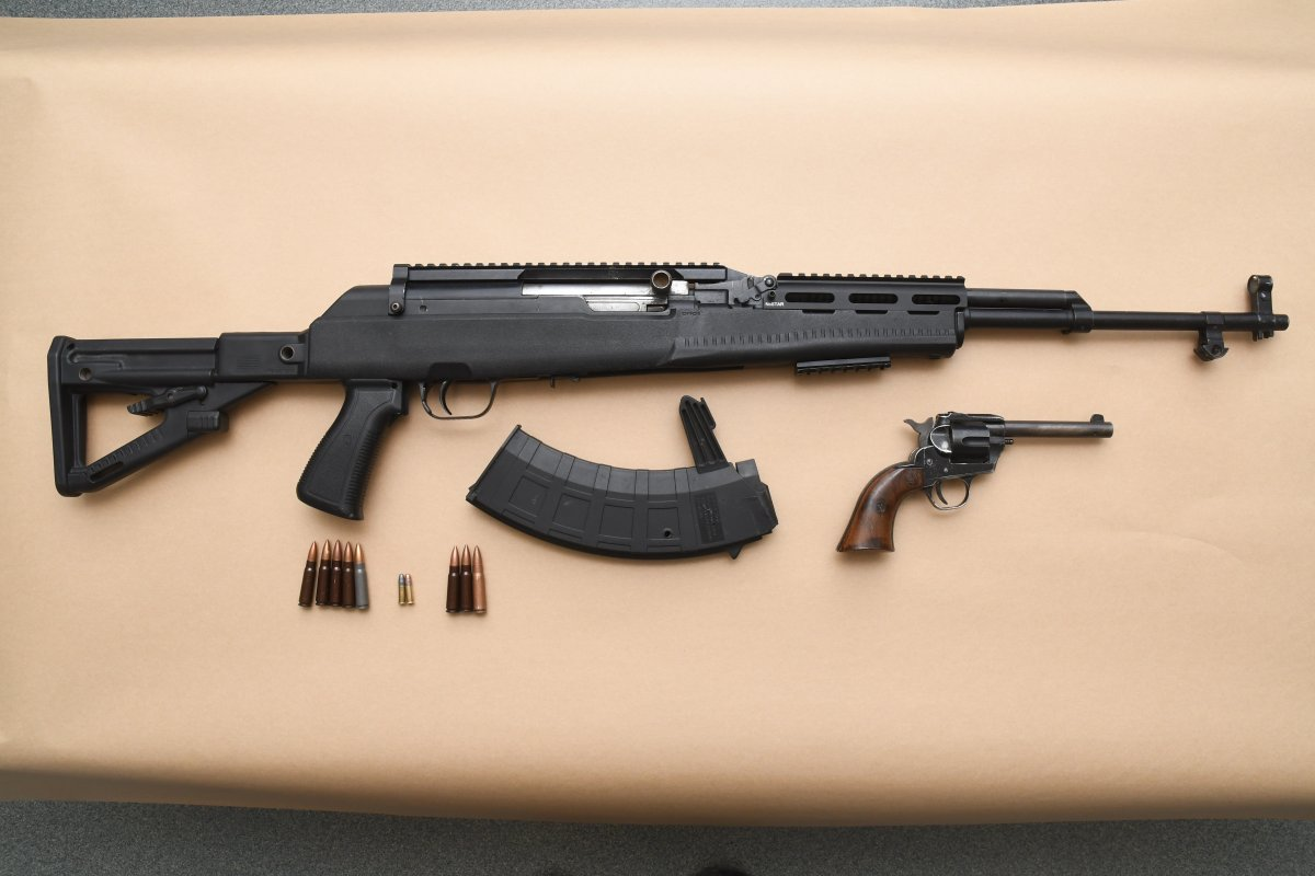 SKS semi-automatic rifle with ammunition and .22 calibre revolver and ammunition.