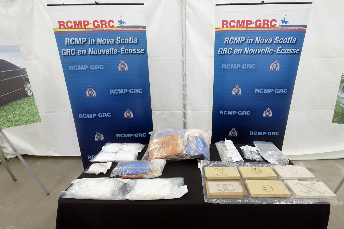 An 11-month investigation has resulted in RCMP charging 14 people with approximately 100 offences. Police have also seized a significant quantity of drugs, firearms and money.