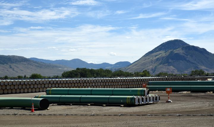 Sections of pipe sit in a storage yard in Kamloops, British Columbia, Canada on June 1, 2021.  The pipe is ready for use in the construction of the Trans Mountain Pipeline.
