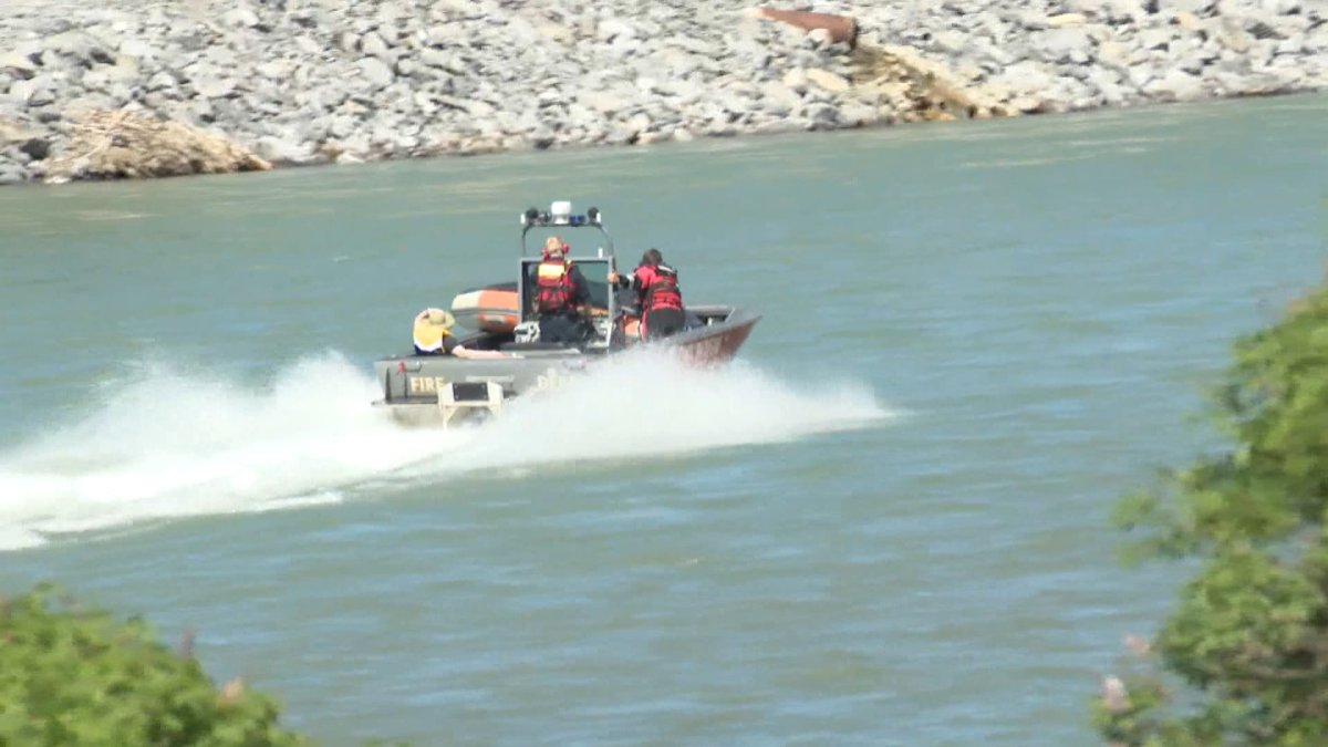 The Calgary Fire Department's water rescue team rescuing rafters on the Bow River on Thursday, June 17.