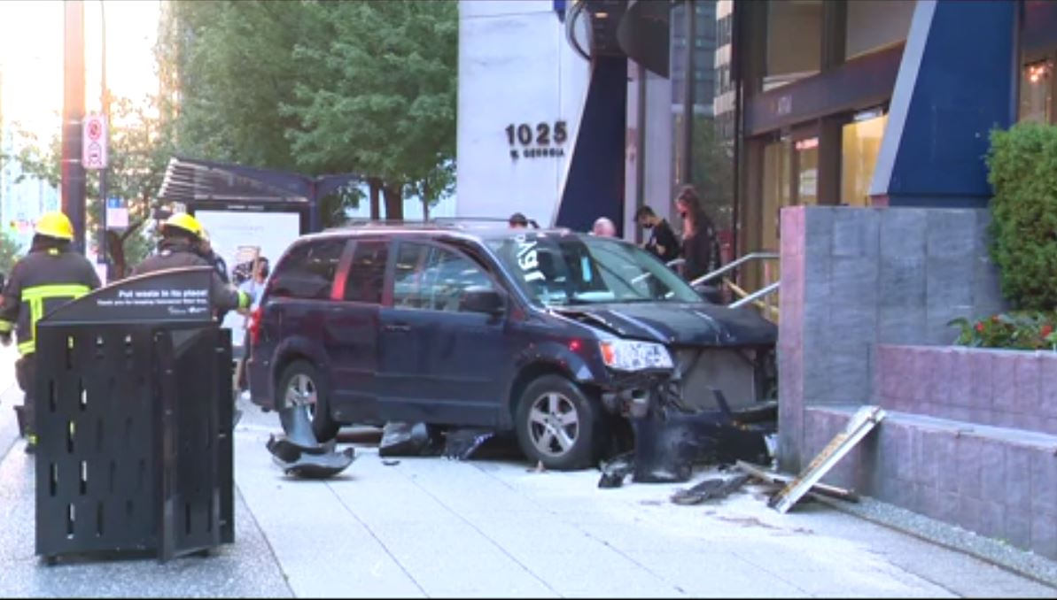 Police are investigating a crash in downtown Vancouver on June 9, 2021.
