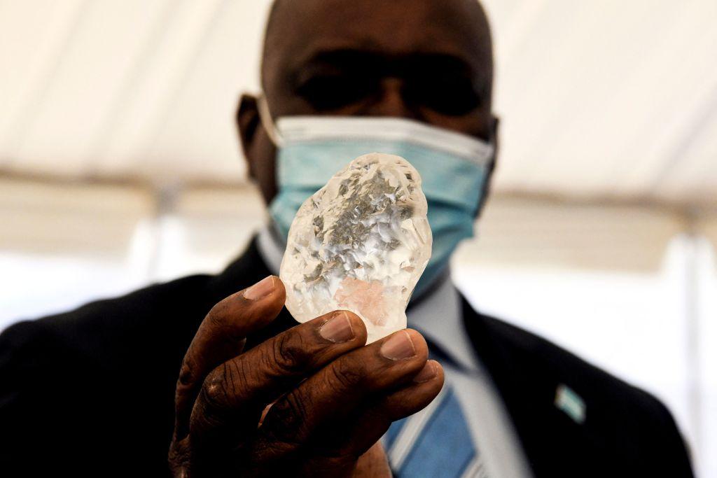 Botswana President Mokgweetsi Masisi holds a gem diamond in Gaborone, Botswana, on June 16, 2021.