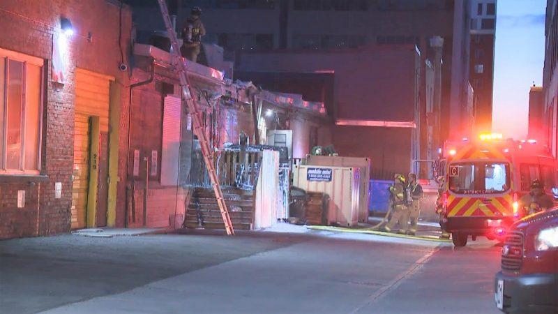Calgary firefighters investigate a dumpster fire on Thursday, June 3, 2021.