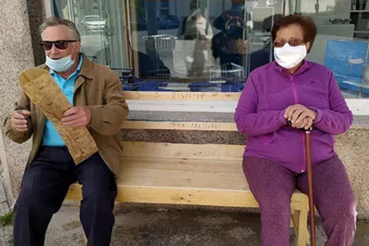 Manuel and Maria Souto are shown on the bench that he build in A Estrada, Spain.