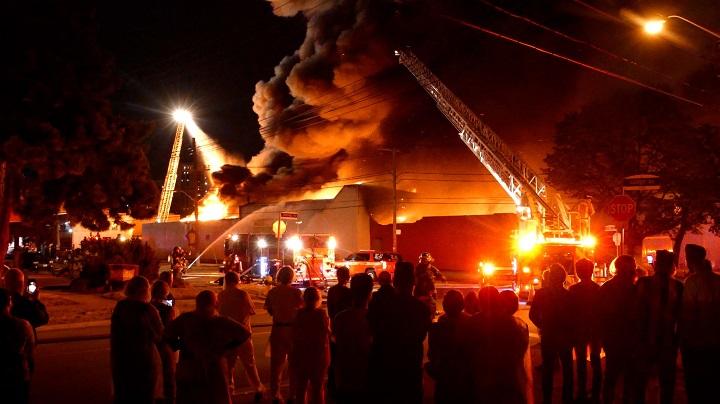 Firefighters on scene of a 5-alarm fire on Bering Avenue in Etobicoke.