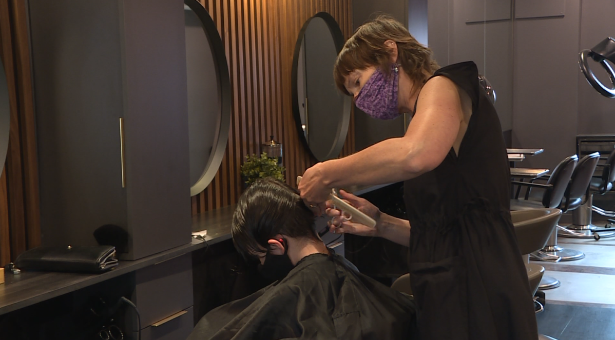 A haircut being given on Saturday at Angles Hair Salon on Lilac.