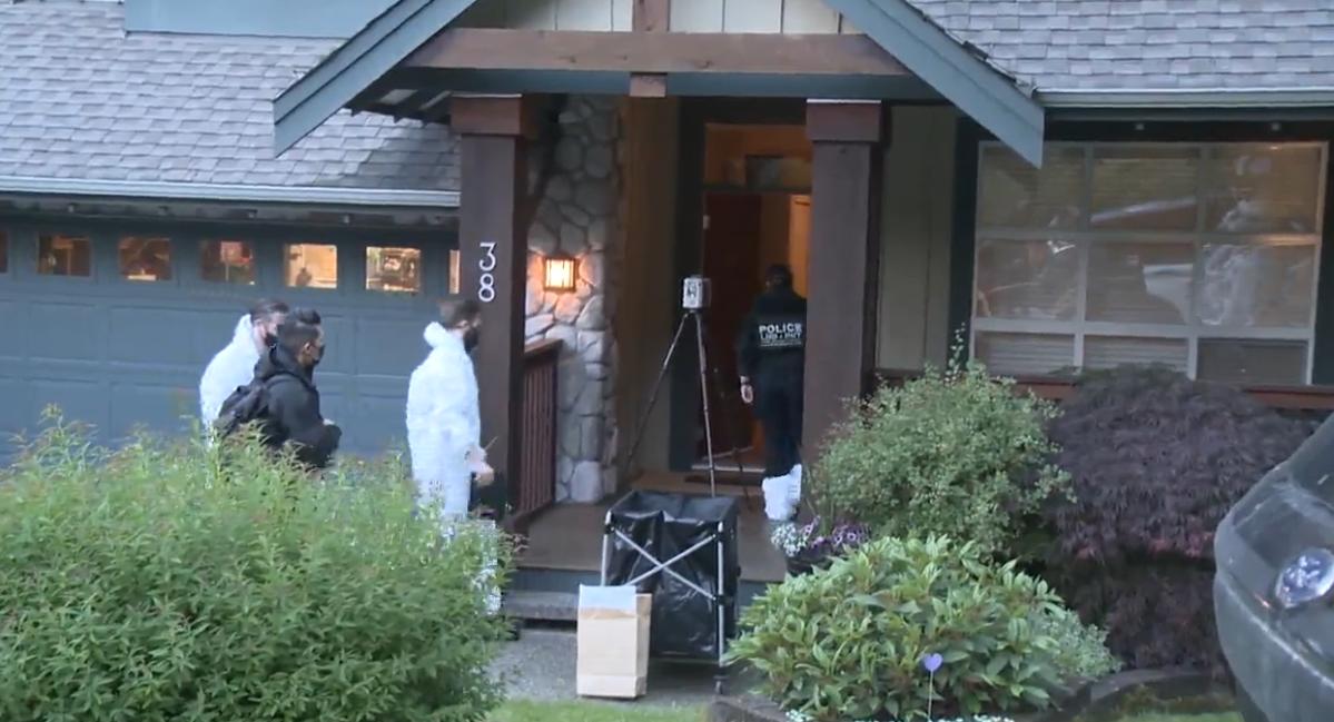 Homicide and forensics investigators enter Trina Hunt's Port Moody home.