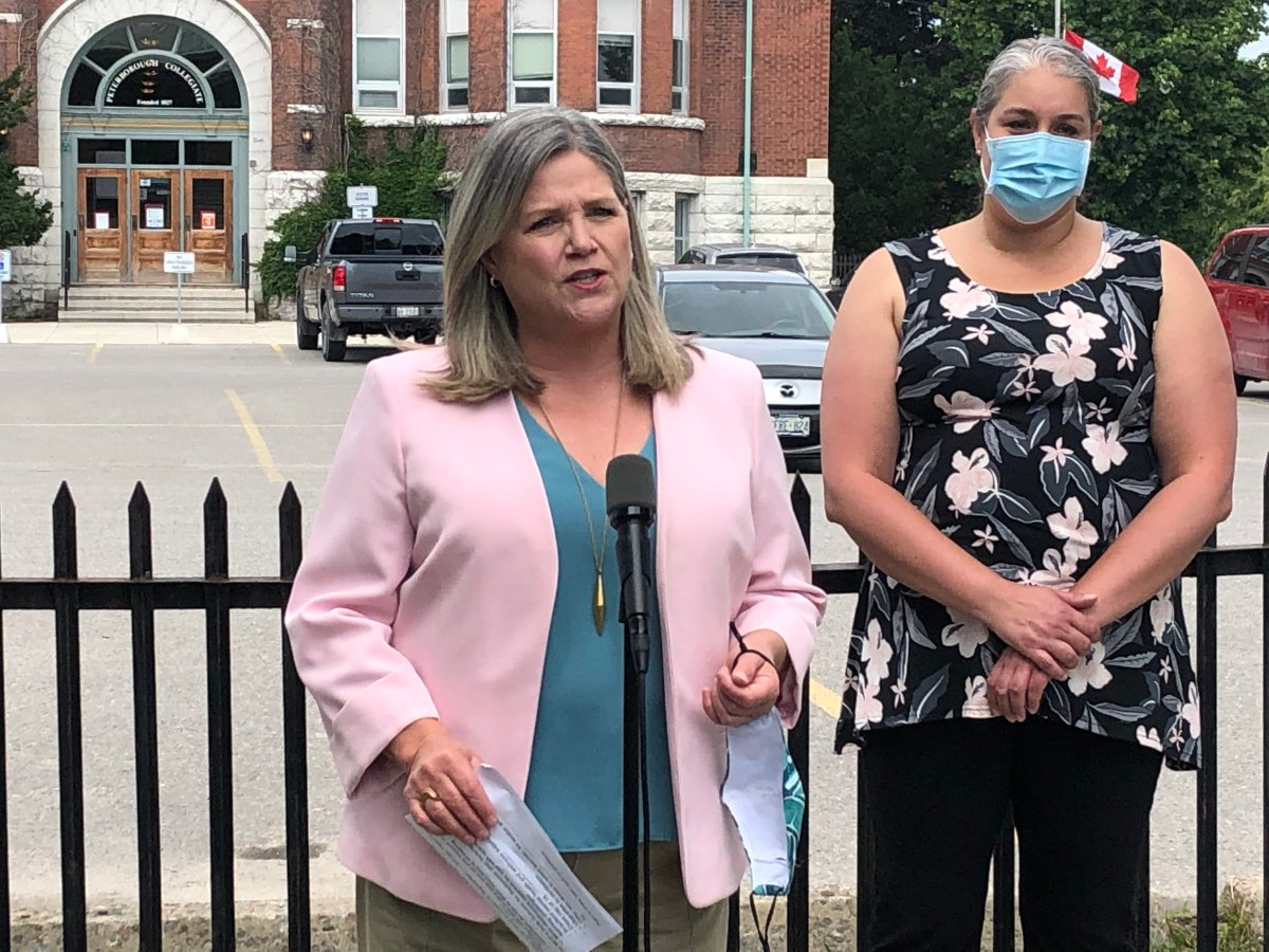 Ontario's official Opposition Leader Andrea Horwath and local Grade 3/4 teacher Erika Mark hold a news conference in Peterborough on June 29, 2021.