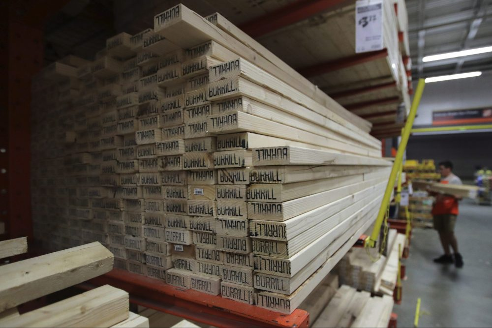 In this July 11, 2019, file photo, lumber is stacked at a Home Depot store in Londonderry, N.H.