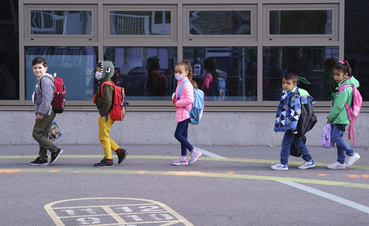 Students try to keep their distance as they enter the Philippe-Labarre Elementary School in Montreal, on Thursday, August 27, 2020.