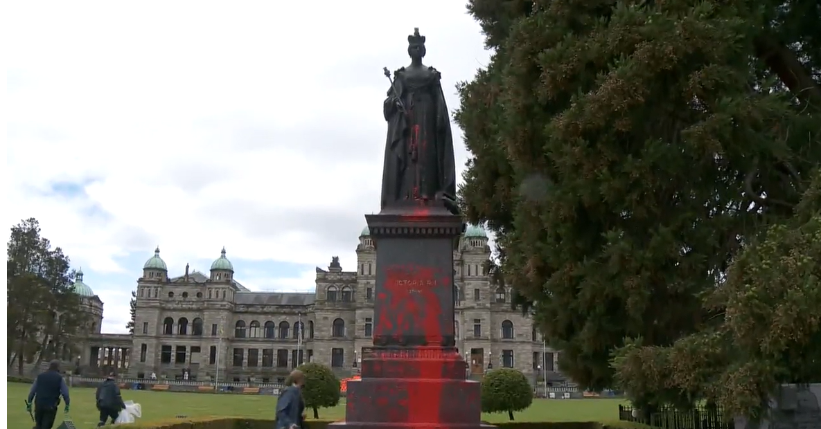 Paint seen splattered on a statue of Queen Victoria at the B.C. legislature on Friday.