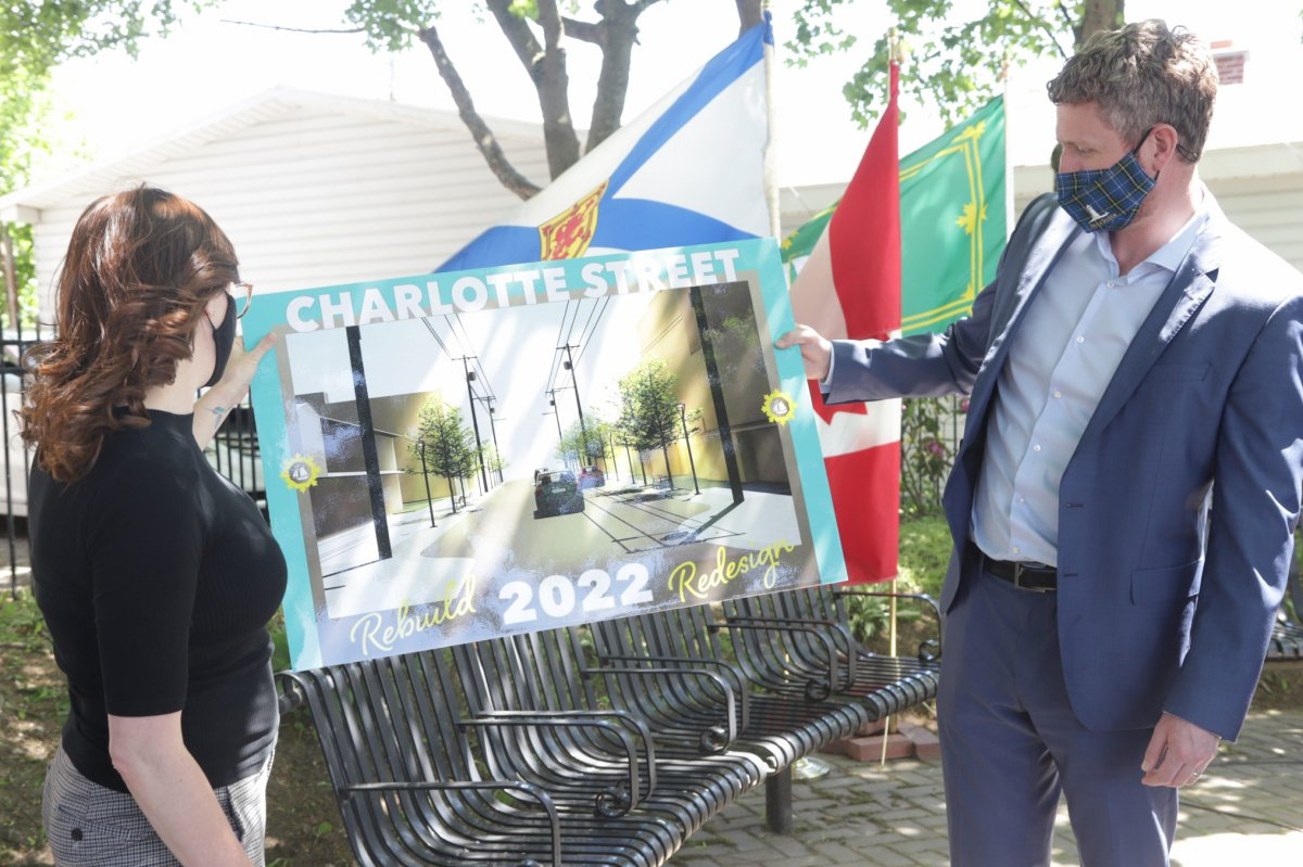 Premier Iain Rankin and CBRM Mayor Amanda McDougall unveil the rendering of the Charlotte Street project in Sydney.