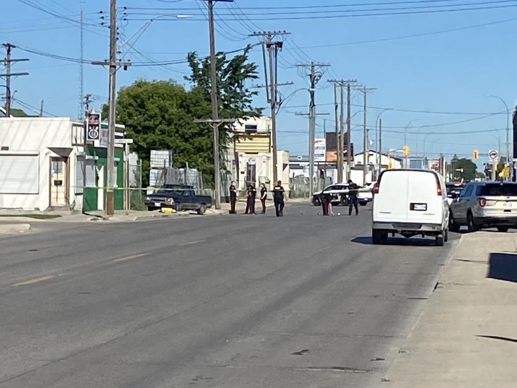 Winnipeg police investigate a hit and run near Logan Avenue and Tecumseh Street Tuesday.