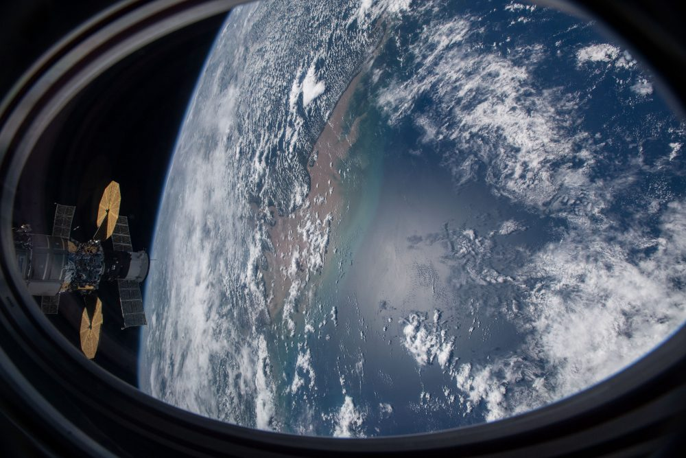 This picture was taken from a window on the SpaceX Crew Dragon vehicle as the International Space Station orbited above the Atlantic Ocean just off the coast of Brazil near the mouth of the Amazon River on Nov. 27, 2020.