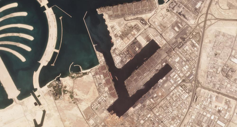 In this satellite photo shot by Planet Labs Inc., the Jebel Ali Port is seen early Wednesday, July 7, 2021, in Dubai, United Arab Emirates. A fiery explosion erupted on a container ship anchored in Dubai at one of the world's largest ports later Wednesday, authorities said, sending tremors across the commercial hub of the United Arab Emirates. (Planet Labs Inc. via AP).