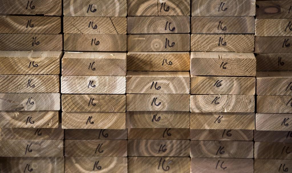 Cedar planks are stacked at a lumber yard, Tuesday, April 25, 2017 in Montreal.Canfor Corp. says it is curtailing production capacity at its Canadian sawmills beginning Monday as a result of extreme wildfire conditions in Western Canada. THE CANADIAN PRESS/Paul Chiasson.