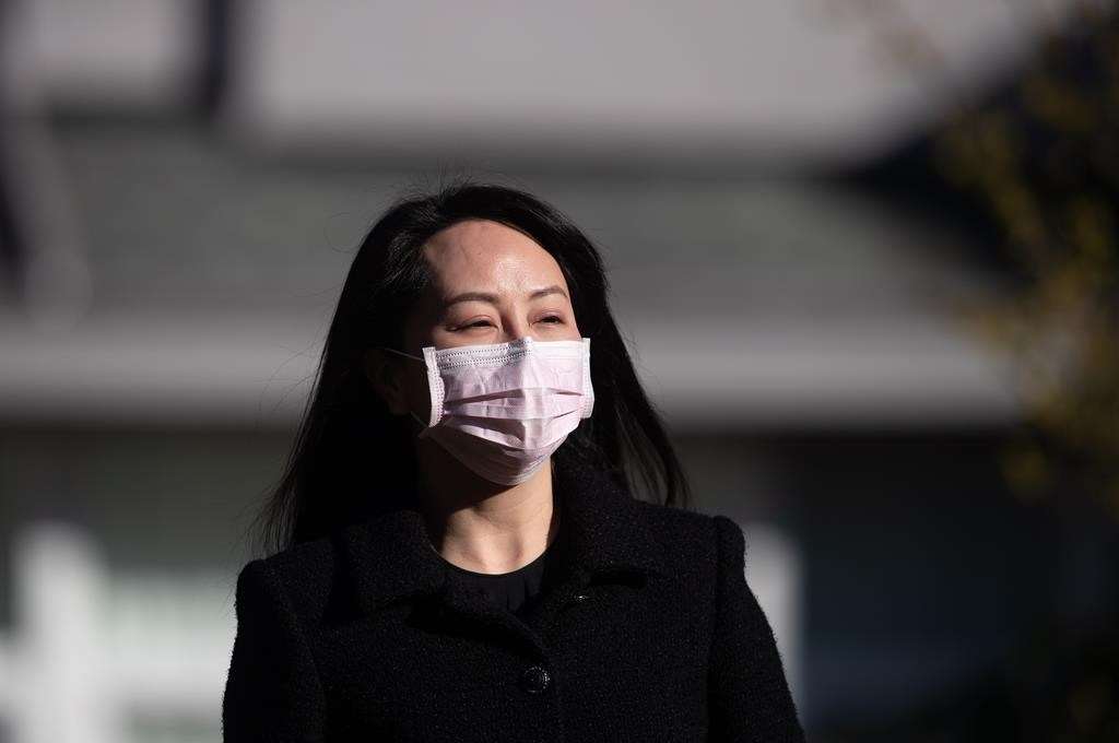 Meng Wanzhou, chief financial officer of Huawei, leaves her home to attend a hearing at B.C. Supreme Court, in Vancouver, on March 29, 2021. THE CANADIAN PRESS/Darryl Dyck.