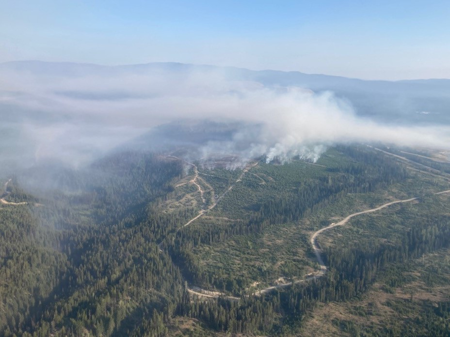 Smoke rises from the Brenda Creek wildfire that's burning near the Okanagan Connector. According to the BC Wildfire Service, smoky conditions and windy skies are preventing accurate wildfire mapping.