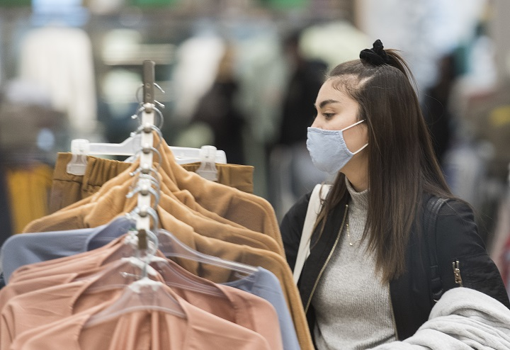 A woman wears a face mask as she shops in a store in Montreal, Sunday, November 22, 2020.