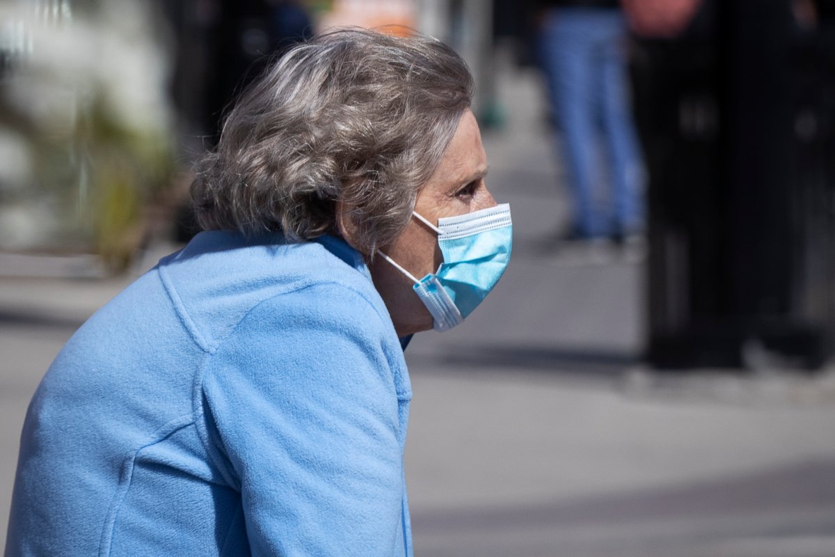 A senior wears a surgical mask to protect them from the COVID-19 virus in Kingston, Ontario on Monday May 10, 2021.