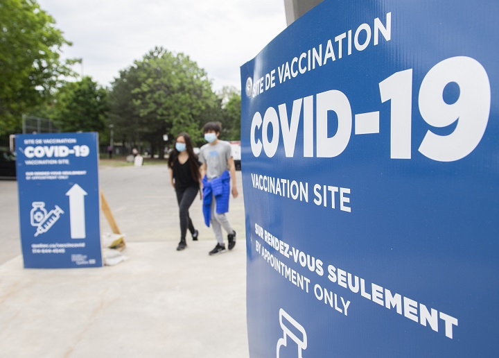 People are shown after receiving a COVID-19 vaccine shot at the Bill Durnan COVID-19 vaccination site in Montreal, Saturday, May 22, 2021, as the COVID-19 pandemic continues in Canada and around the world.