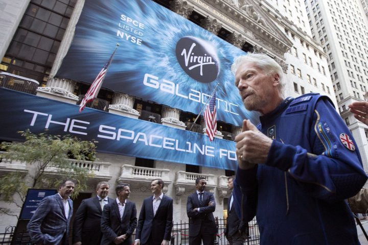 FILE - In this Monday, Oct. 28, 2019 file photo, Richard Branson, right, founder of Virgin Galactic, and company executives gather for photos outside the New York Stock Exchange before his company's IPO.