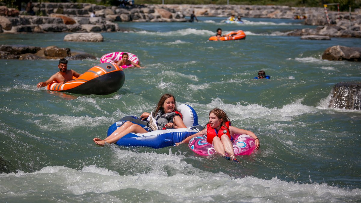 People raft in the Bow River trying to beat the heat in Calgary, Alta., Wednesday, June 30, 2021.