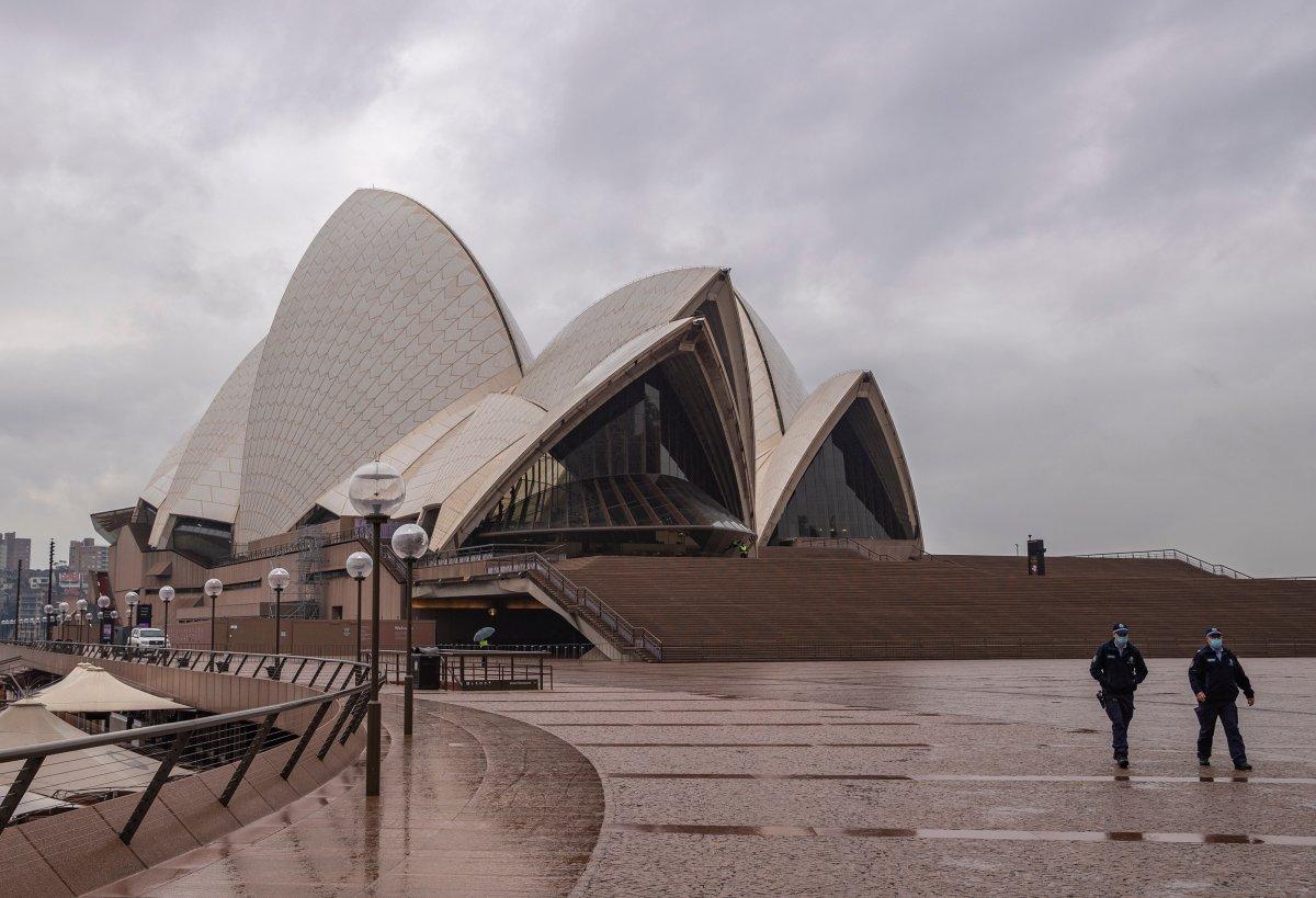SYDNEY, July 9, 2021  Police officers patrol in front of Sydney Opera House in Sydney, Australia, on July 9, 2021.