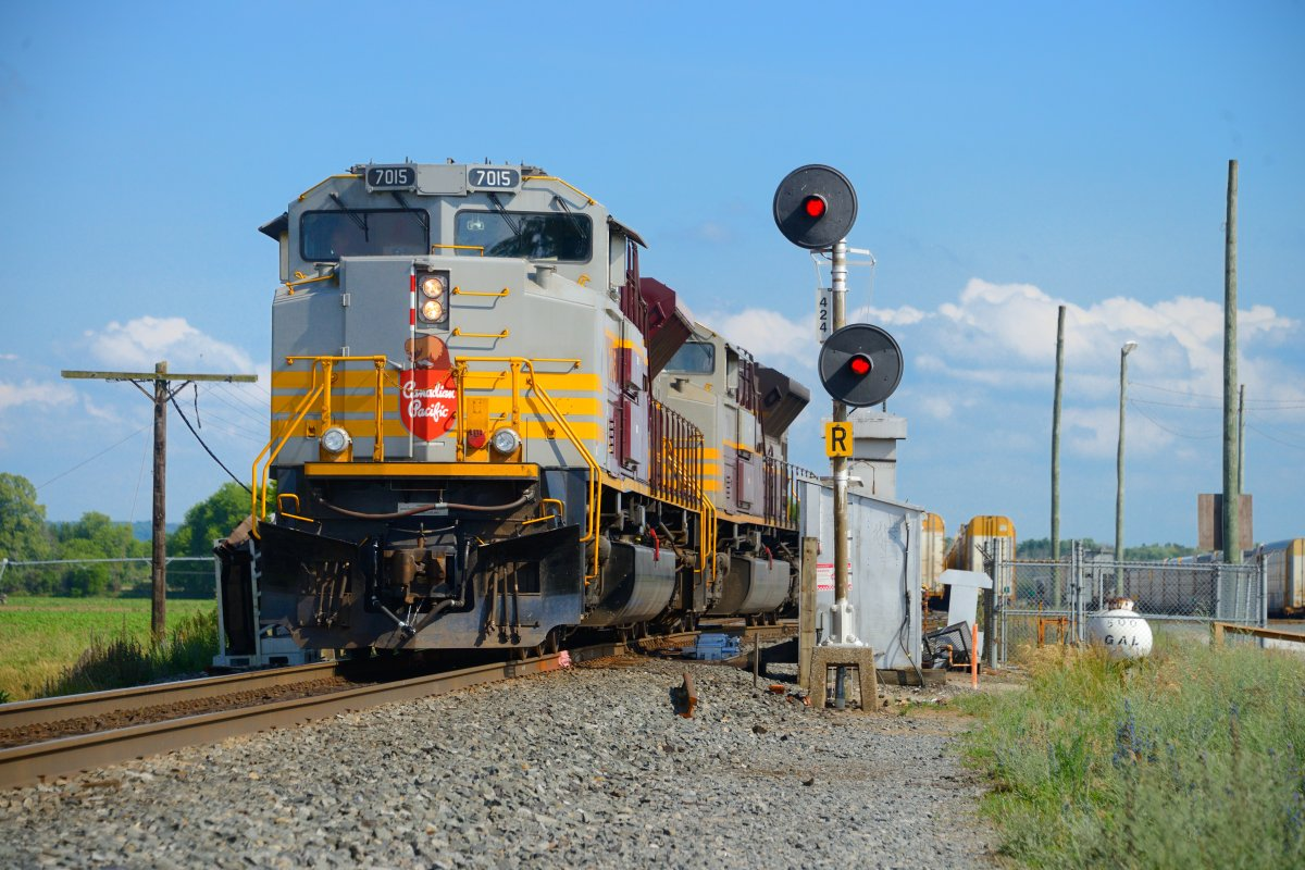 While CN and CP battle for KCS, a pair of heritage painted Canadian Pacific Railway locomotives work a yard with a vintage non PTC compliant stop signal near Alliston Ont., June 26, 2021.