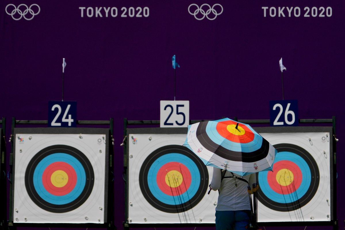 FILE -- An athlete from Ukraine walks to collect her arrows as she practices for the 2020 Summer Olympics at Yumenoshima Park Archery Field, Sunday, July 18, 2021, in Tokyo. (AP Photo/Charlie Riedel).