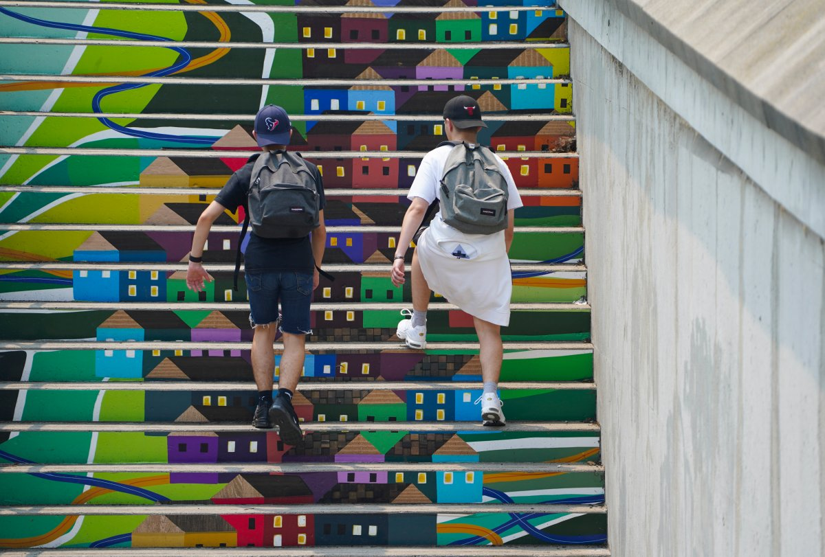Two people make their way up a painted staircase in Ottawa on Monday, July 19, 2021.