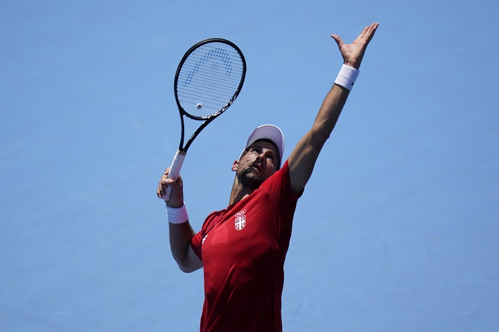 Novak Djokovic, of Serbia, practices at the Ariake Tennis Center ahead of the 2020 Summer Olympics, Friday, July 23, 2021, in Tokyo, Japan.