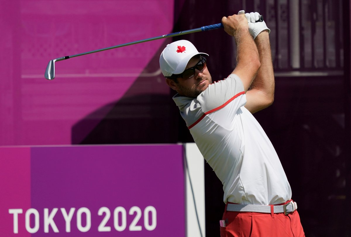 Canada's Corey Conners watches his tee shot on the first hole during a practice round of the men's golf event at the 2020 Summer Olympics, Tuesday, July 27, 2021, at the Kasumigaseki Country Club in Kawagoe, Japan, (AP Photo/Matt York).