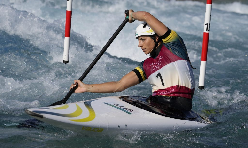 Jessica Fox of Australia competes in the Women's C1 heats of the Canoe Slalom at the 2020 Summer Olympics, Wednesday, July 28, 2021, in Tokyo, Japan. (AP Photo/Kirsty Wigglesworth).