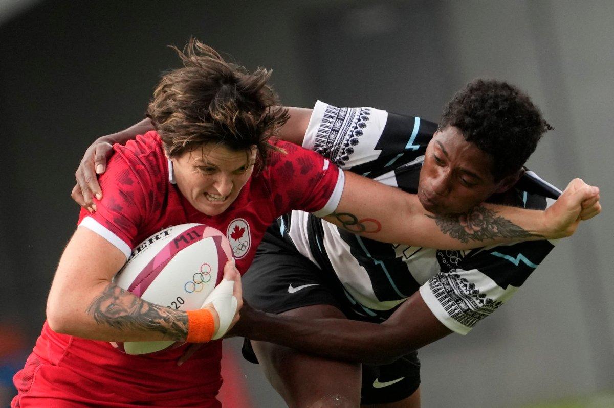 Canada's Britt Benn, left, is tackled by Fiji's Ana Maria Naimasi in their women's rugby sevens match at the 2020 Summer Olympics, Thursday, July 29, 2021 in Tokyo, Japan. (AP Photo/Shuji Kajiyama).