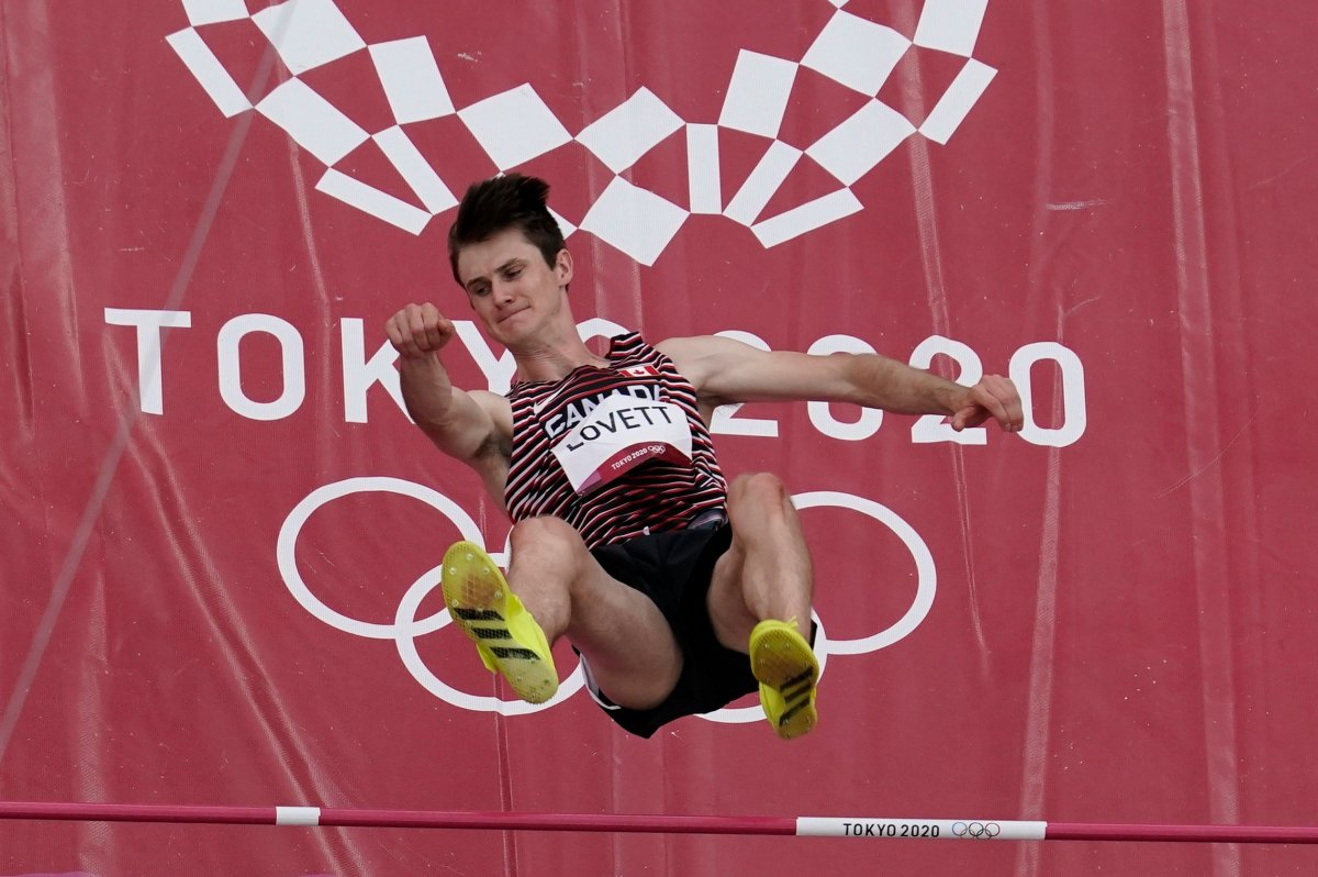 Django Lovett, of Canada, competes during a preliminary round of the men's high jump at the 2020 Summer Olympics, Friday, July 30, 2021, in Tokyo. (AP Photo/Morry Gash).